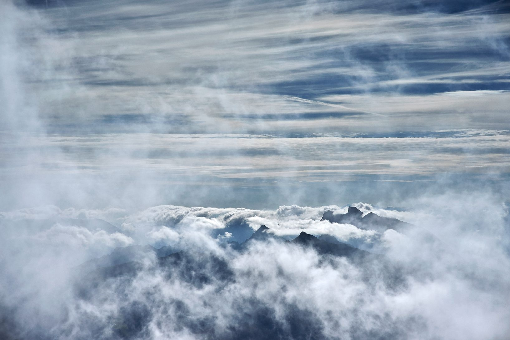 Clouds over mountain tops
